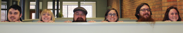 Instructional Design Team Heads over wall
