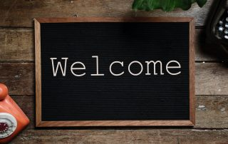 Letters spelling welcome on a letterboard